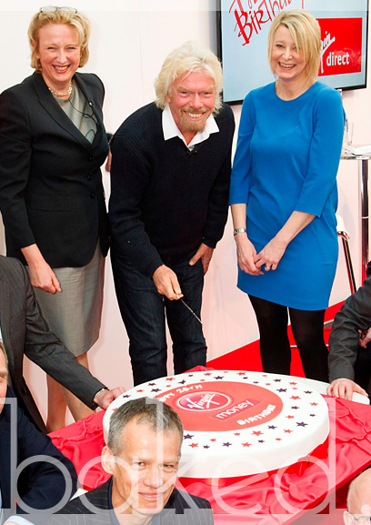 Richard Branson cuts presentation cake for Virgin Money