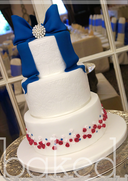 Royal Blue Bow & Rose Wedding Cake