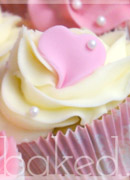 Pretty heart and flower christening cupcakes